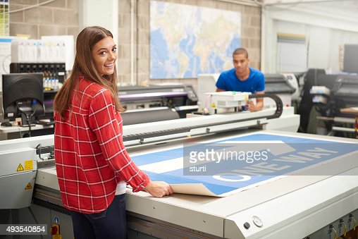 young woman working at a digital printers