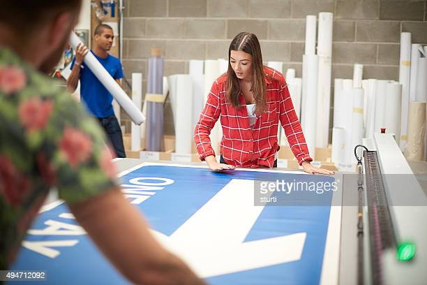 young woman working at a digital printing company