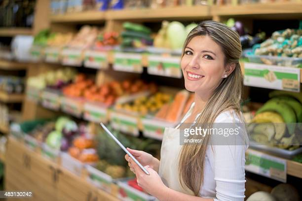 Young woman working at a supermarket