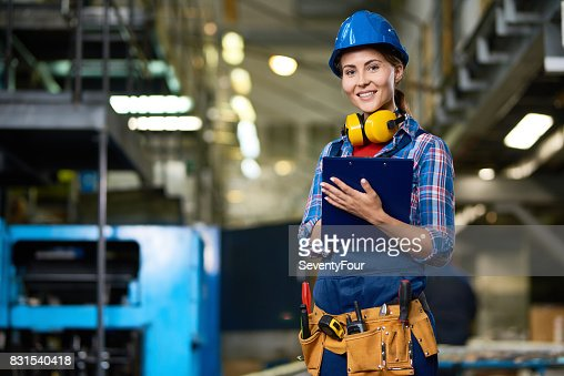 Young Woman Working at Factory : Foto stock