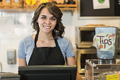 Young woman working in cafe