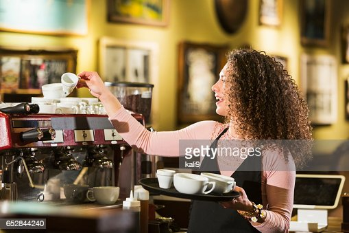 Young woman working in coffee shop : Stock Photo