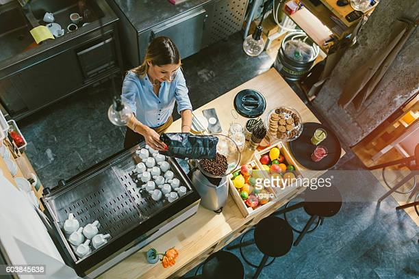 Young Woman Working In Her Cafe