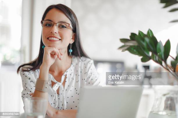 Young woman working in her offfice