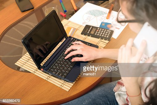 Young woman working in home office : Stock Photo