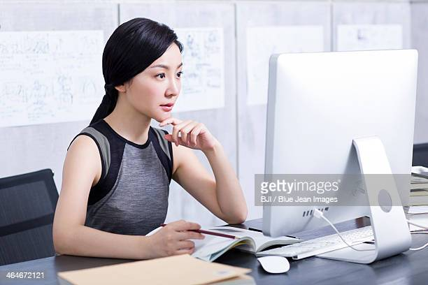 Young woman working in office