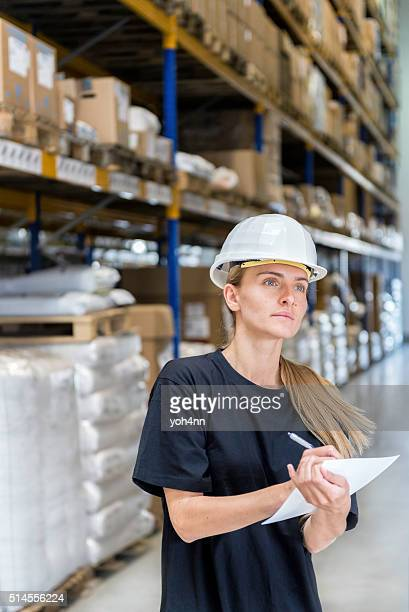 Young woman working in warehouse