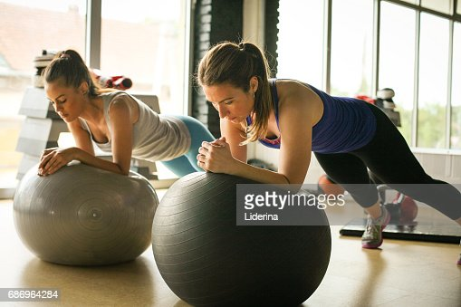 Young woman workout in healthy club. Young woman on Pilates ball. : Stock Photo