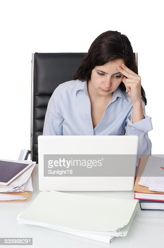 Young woman worried in her office. : Stock Photo