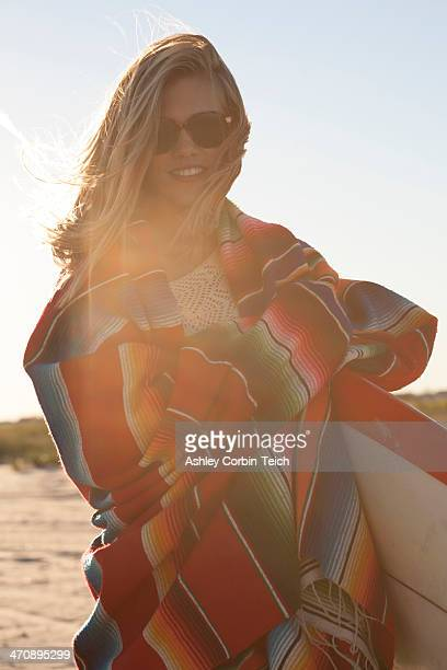 Young woman wrapped in blanket, Breezy Point, Queens, New York, USA