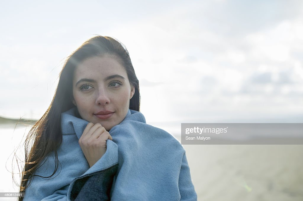 Young woman wrapped in blanket : Stock Photo