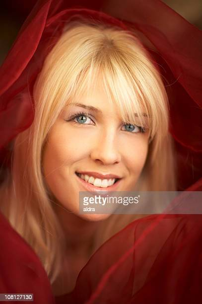 Young Woman Wrapped in Red Shawl Scarf