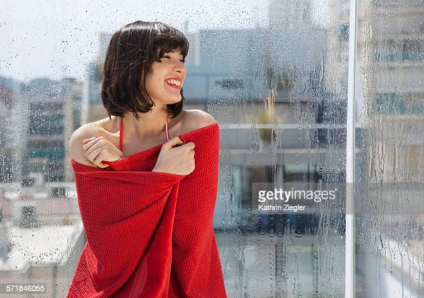 young woman wrapped in red towel