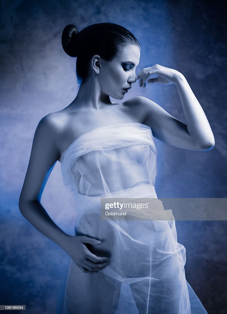Young Woman Wrapped in White Veil : Stock Photo