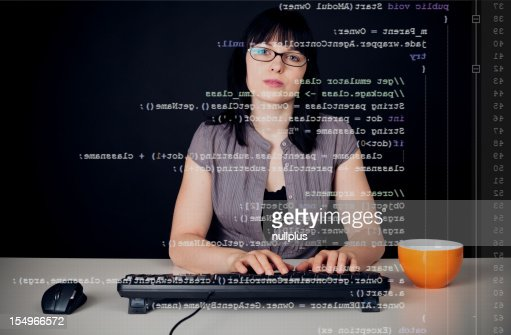 young woman writing a java program
