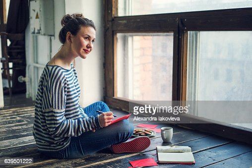 Young woman writing a valentine card