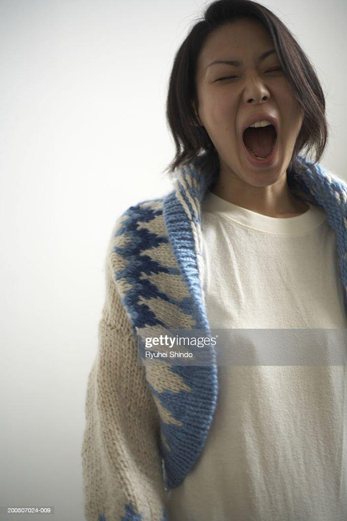 Young woman yawning : Stock Photo