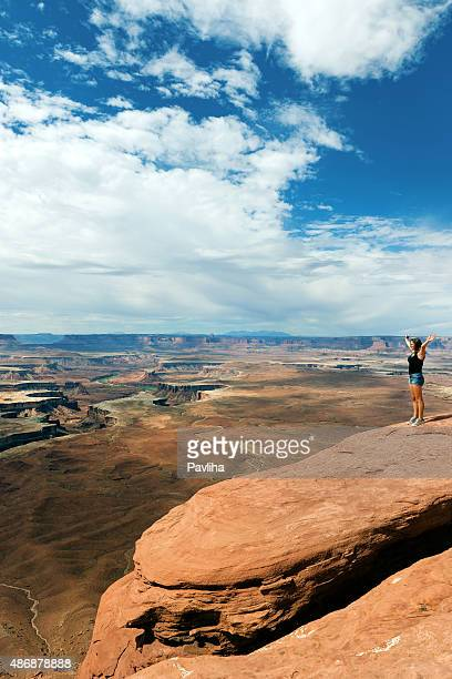 Young Woman,Hands raised, Enjoying View of Grand Canyon USA