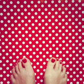 young woman's bare feet with red painted