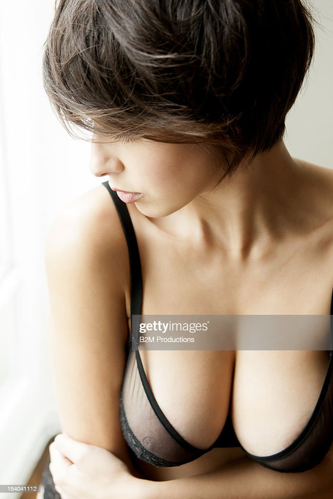 Young Woman's Cleavage In Lingerie