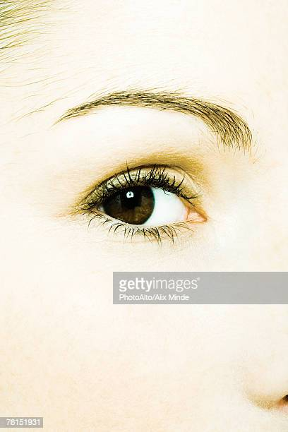 'Young woman's eye, extreme close-up'