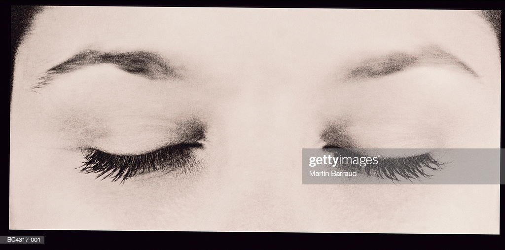 Young woman's eyes, closed, close-up (toned B&W) : Stock Photo
