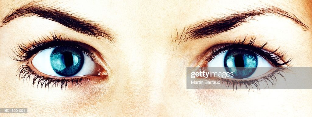 Young woman's eyes, close-up (cross-processed) : Stock Photo