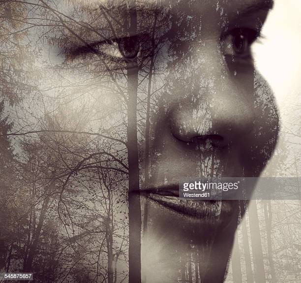 Young womans face and silhouettes of trees in a wood, Double Exposure