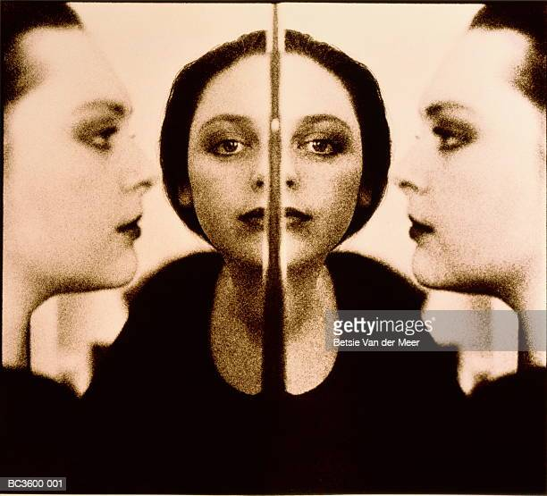Young woman's face, multiple reflections (montage, toned B&W)
