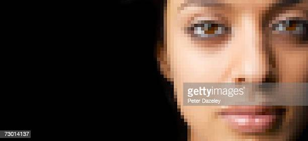 Young woman's face pixelated, close-up