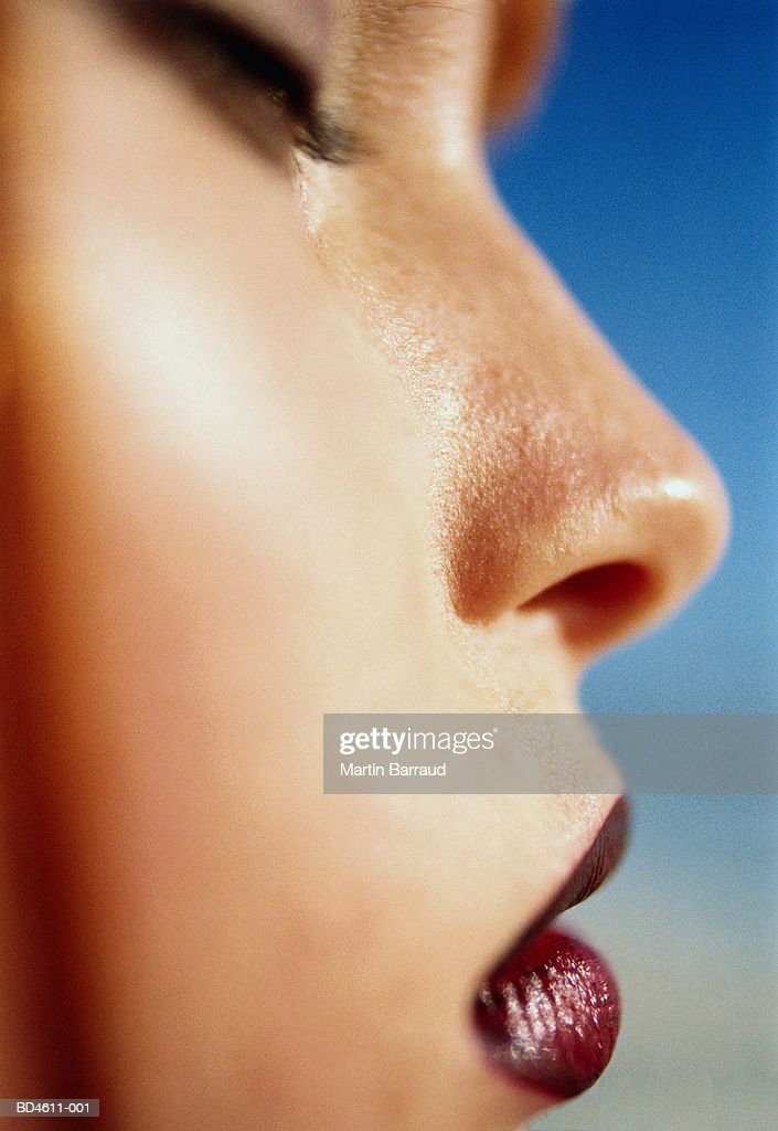 Young woman's face, profile, close-up : Stock Photo