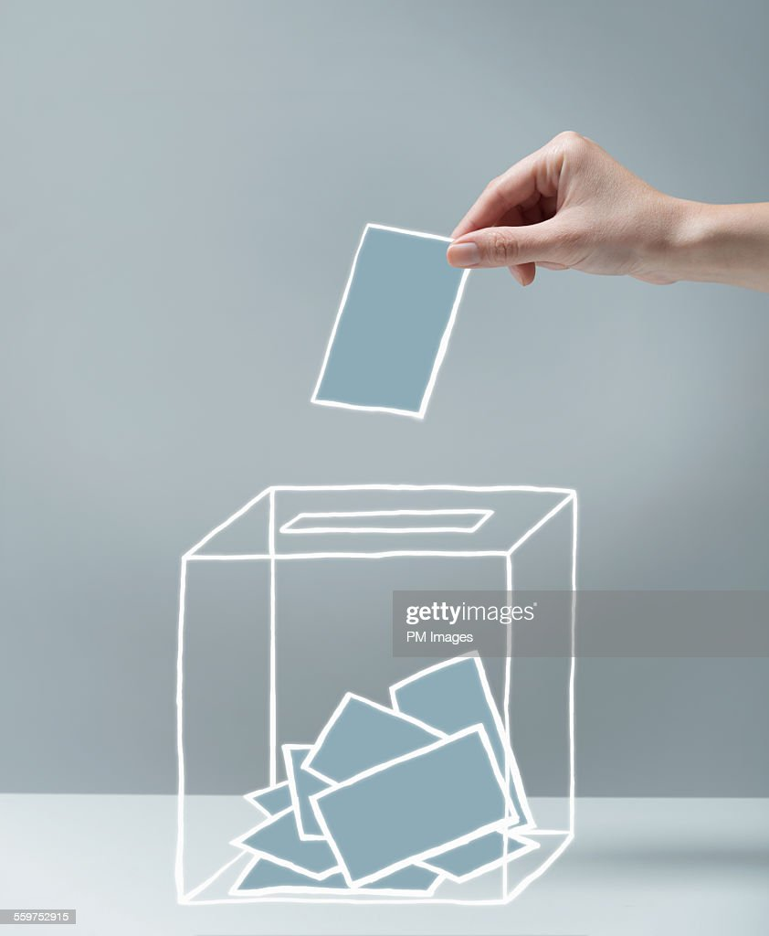 Young woman's hand voting : Stock Photo