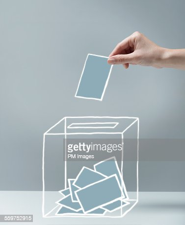 Young woman's hand voting
