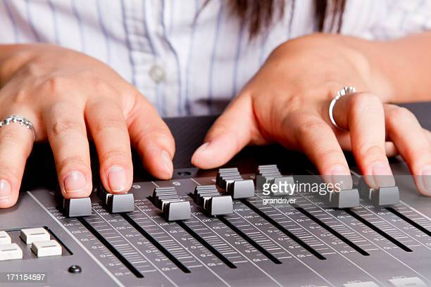 Young Woman's hands at a Recording Console