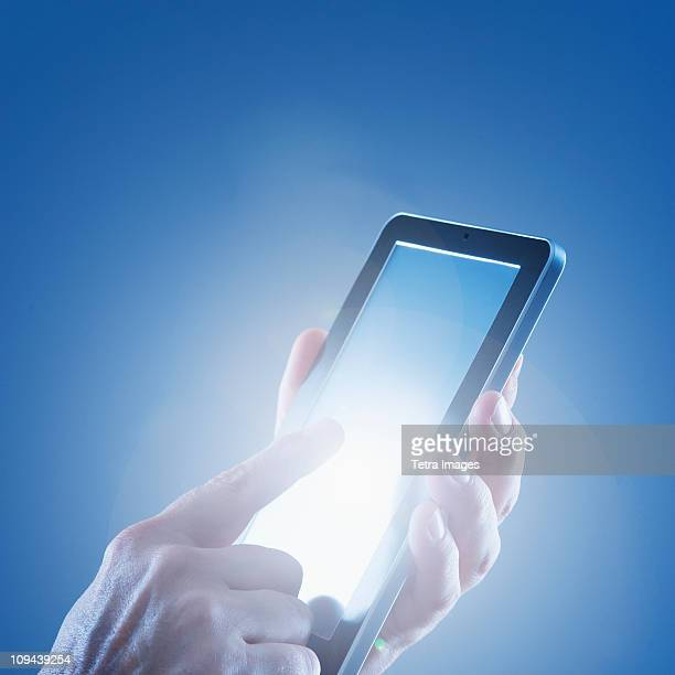 Young woman's hands using digital tablet