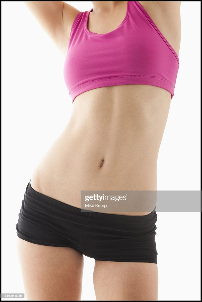 Young woman's with slim belly