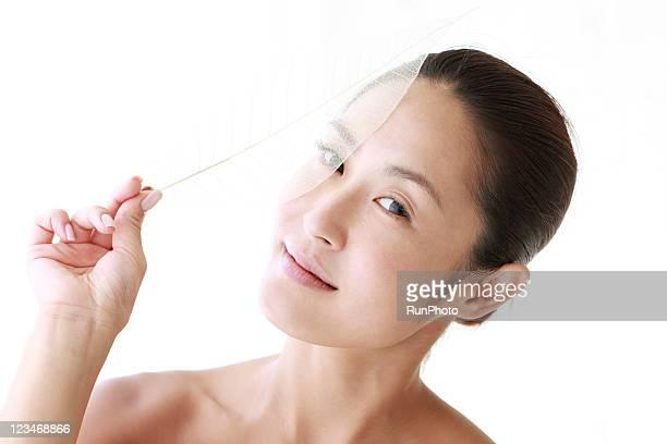 young woman&transparent leaf,portrait