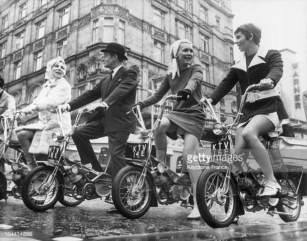Young women and gentleman on mini RALEIGH WISP motorcycles in London in 1967
