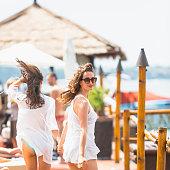 Girl are walking on beach pier