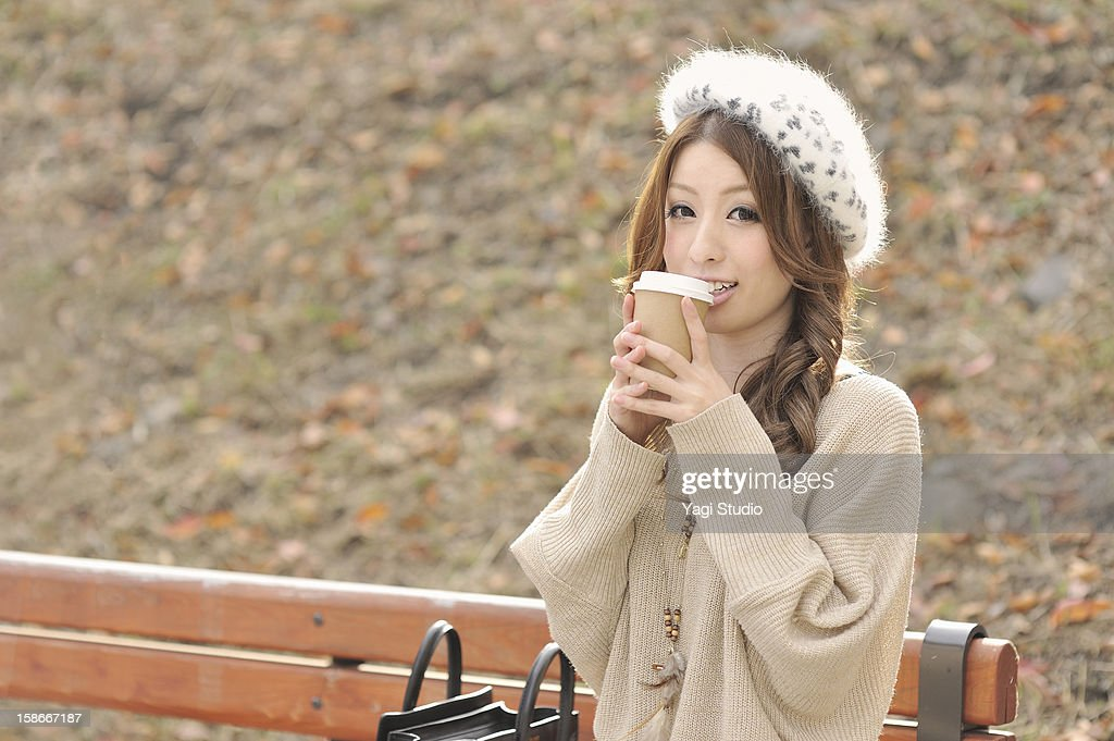 Young women are relaxing in the park : Stock Photo