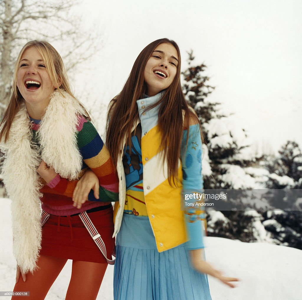 Young Women Arm in Arm in Snow