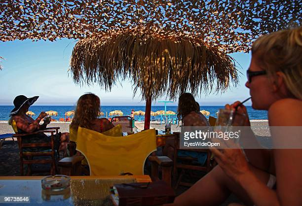 Young women at the Mojito Bar and Beachbar on July 16 2009 in Rhodes Greece Rhodes is the largest of the Greek Dodecanes Islands