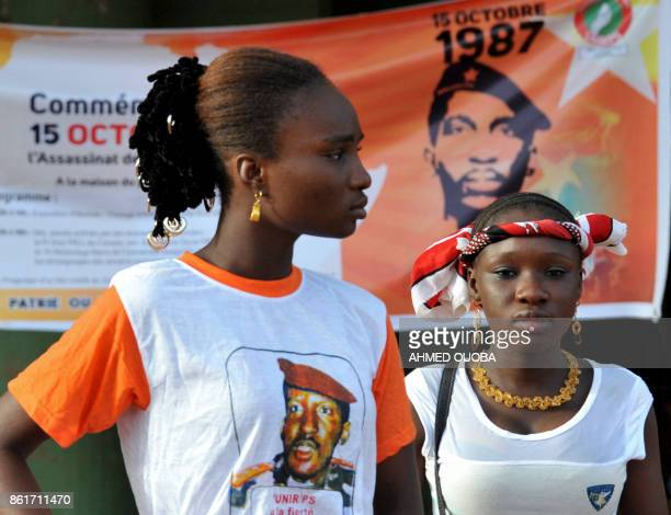 Young women attend a ceremony marking the 30th anniversary of the death of late Burkina Faso's leader Thomas Sankara on October 15 2017 in...