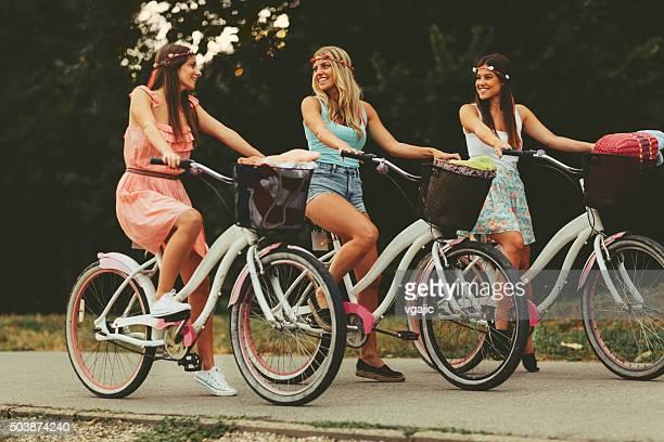 Young women biking