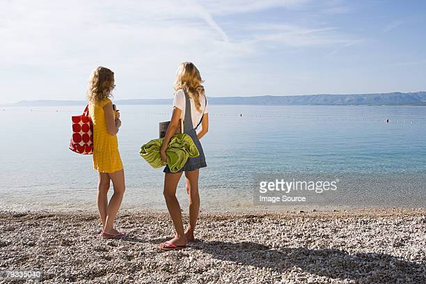 Young women by the sea