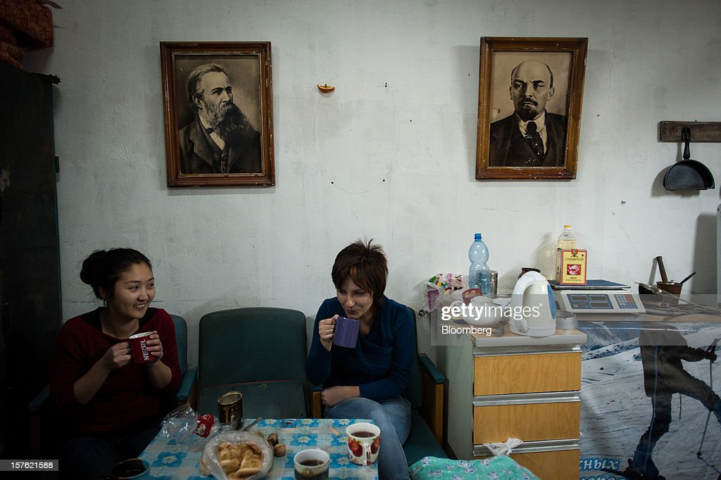 Young women chat in a room inside a factory building in Bishkek, Kyrgyzstan, on Wednesday, Nov. 14, 2012. Landlocked Kyrgyzstan is the only country in the world that hosts both Russian and U.S. military bases. Photographer: Noriko Hayashi/Bloomberg via Getty Images