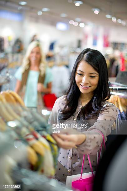 young women clothes shopping