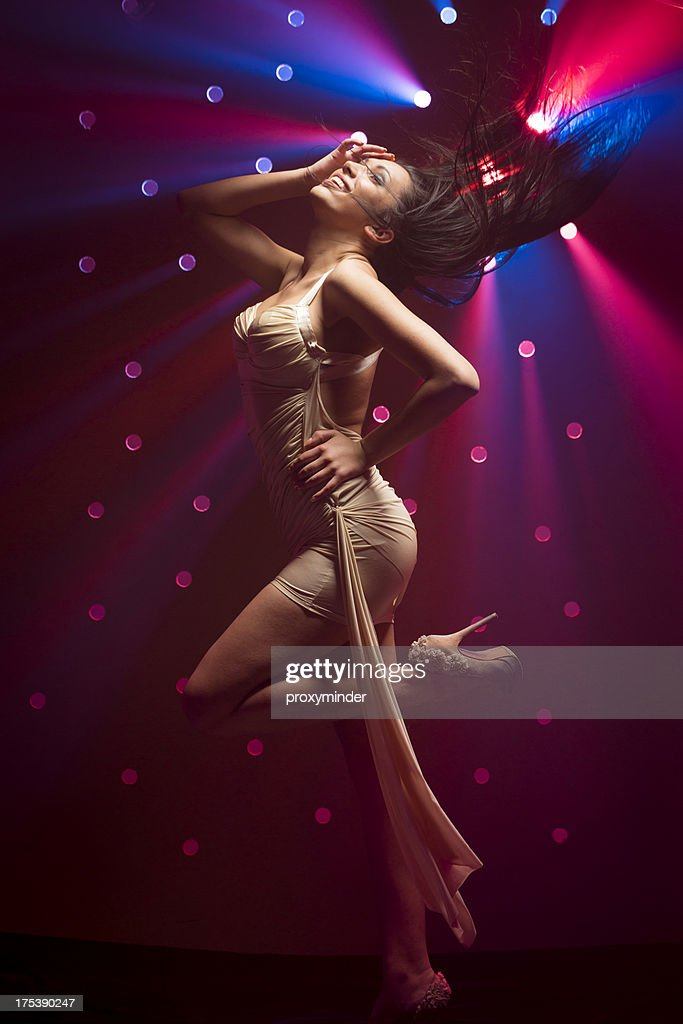 Young women dancing on smoky disco background : Stock Photo