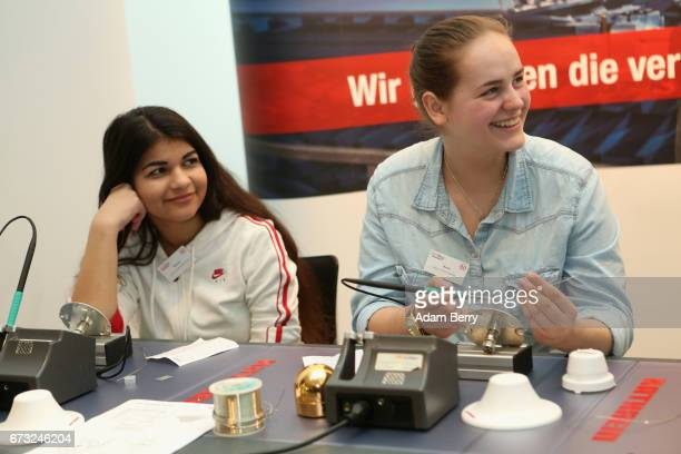 Young women demonstrate welding on Girls' Day on April 26 2017 in Berlin Germany The event is meant to encourage young women to pursue careers in all...