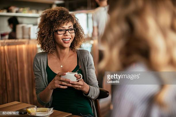 Young women drinking coffee at a cafe